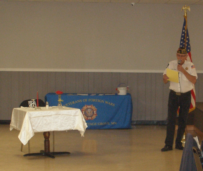 Post Commander Bruce Heil leads the POW-MIA table of honor ceremony near during the 2016 Veterans Day dinner event.