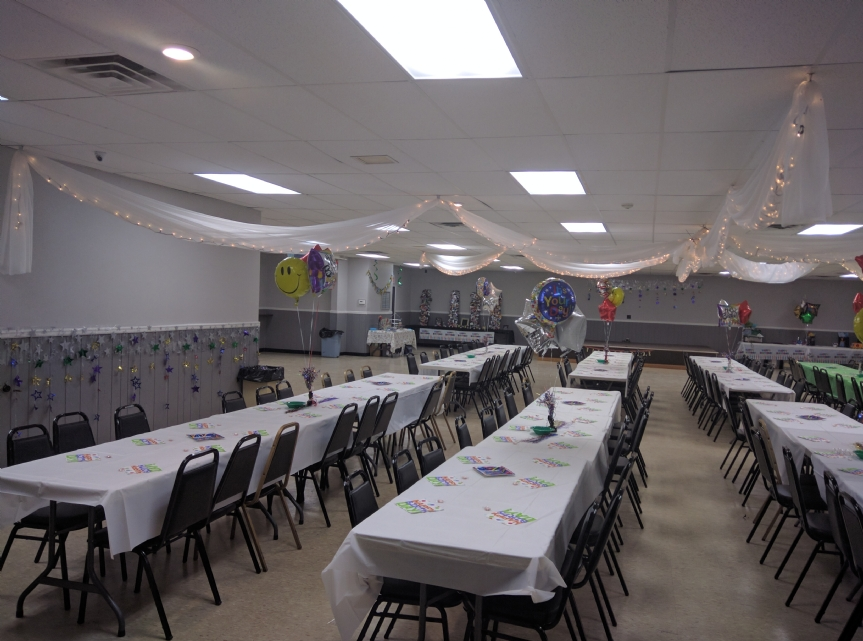 Another view of the hall decorated for an adult birthday party.