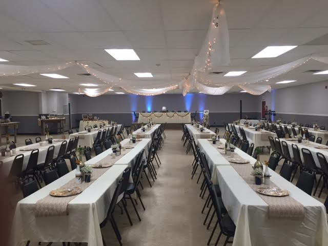 An example of the hall decorated for a wedding or reception. This layout has the head table on the stage.