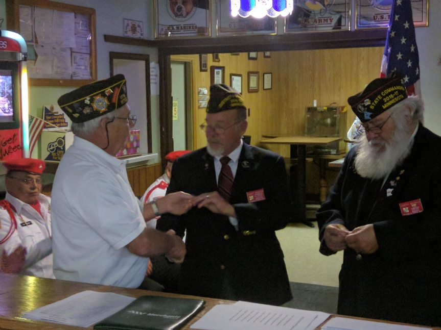 Nov. 19, 2016 at Cottage Grove VFW Post 8752: Chuck Cronquist presents Vets Camp challenge coins to 4th District Commander Robert Webster and VFW Minnesota State Commander Joe Mauricio.